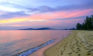 Sandy Ong Lang Beach at Phu Quoc Island in Vietnam, during sunset that coloured its skys orange, yellow, and different shades of purple and pink