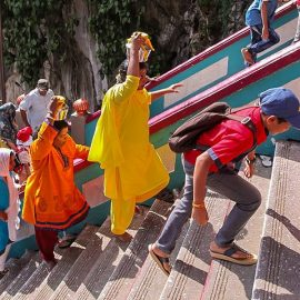 Photograph of pilgrims climbing the stairs of Batu Caves and carrying Paal Kudam, brass pots filled with milk, as offerings for Thaipusam festival, photo by Ivan Kralj