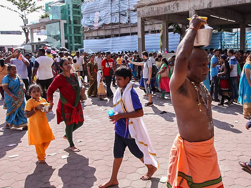 Photograph of pilgrims carrying Paal Kudam, brass pots filled with milk, as offerings for Thaipusam festival, photo by Ivan Kralj