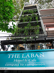 The facade of hotel Laban in Saigon, covered by the greenery