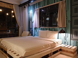 Simply decorated double room in hotel The Laban in Ho Chi Minh City Vietnam. Blue wood on the walls and spacious windows, photo by Ivan Kralj