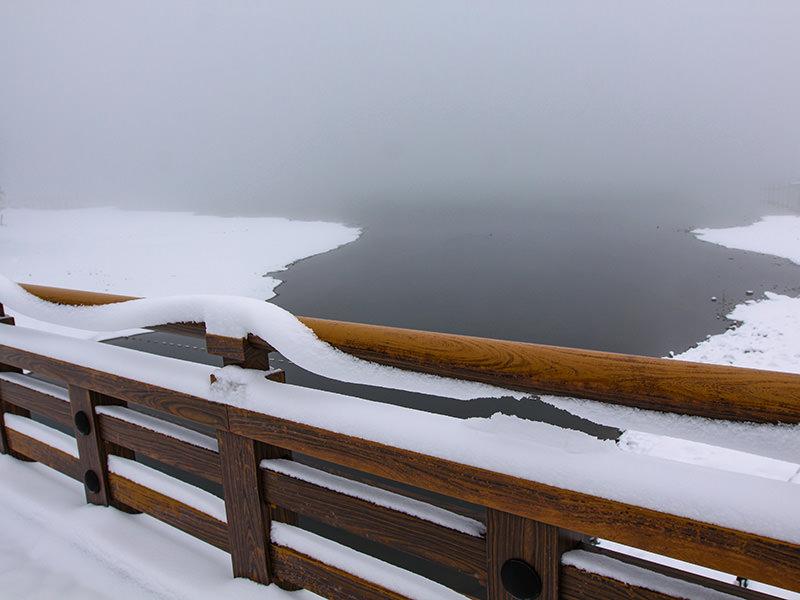 Snow gliding off the handrails at the bridge at the snow-surrounded Chuzenji Lake, close to Nikko, Japan, photo by Ivan Kralj