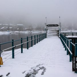 """Snow-covered pier at Chuzenji Lake, Japan. The sign with somewhat ironic name """"Sunrise Pier"""" is visible. Photo by Ivan Kralj"""