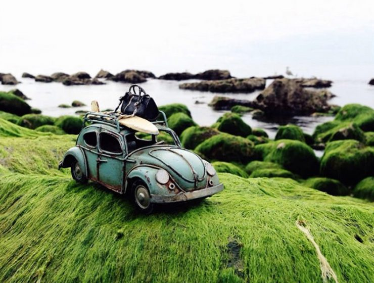 Vintage Volkswagen toy car on the shore, photo by Kim Leuenberger