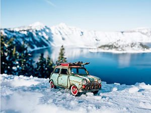 One of Kim Leuenberger's vintage toy cars in the snowy mountain, photo by Kim Leuenberger