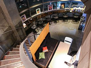 ARTnSHELTER hostel lobby photographed from above, with staircase and seating areas for reading books or chilling out, in Tokyo, Japan, photo by Ivan Kralj