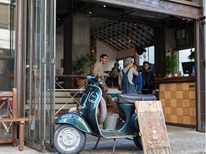 One of the most hipster hostels in Tokyo: Vespa moped at the entrance of Nui. hostel and bar lounge, in Tokyo, Japan, photo copyright by Nui
