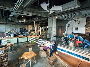 People sitting in the bar lounge at Nui hostel in Tokyo, Japan, photo copyright by Nui