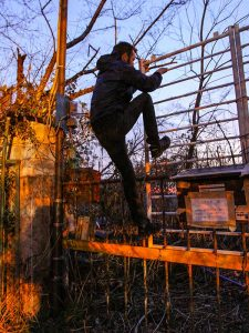 Pipeaway's blogger Ivan Kralj climbing over the fence of the Nara Dreamland site in Nara, Japan, photo by Mladen Koncar