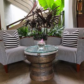 Chairs and rain drum turned table at Jaya House River Park hotel lobby, in Siem Reap, Cambodia, photo by Ivan Kralj