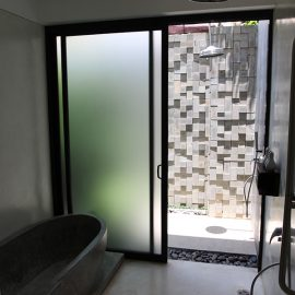Bathroom with a bath tub and rain shower in Junior Suite of Jaya House River Park hotel, in Siem Reap, Cambodia, photo by Ivan Kralj