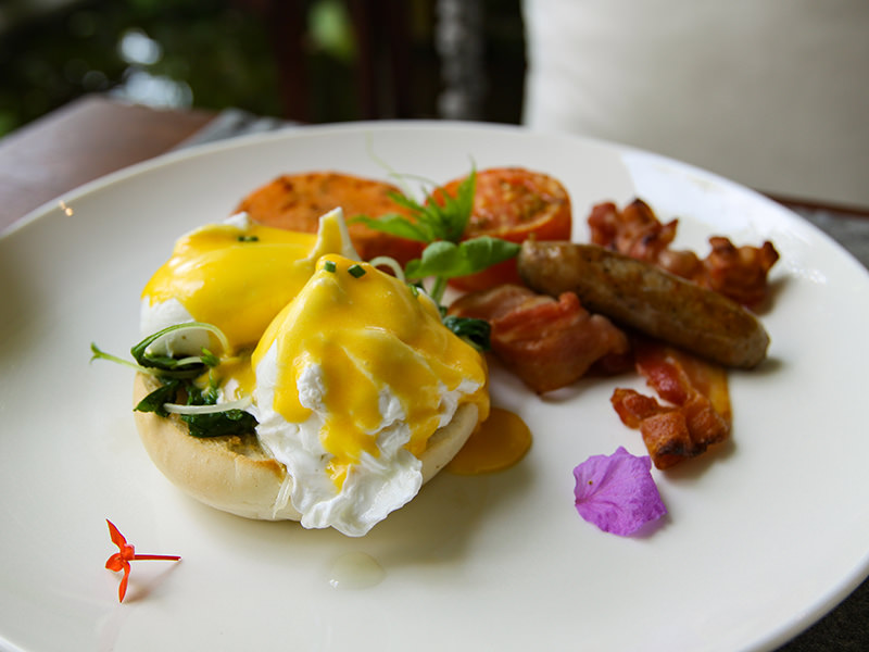 Eggs Florentine served for breakfast on the swinging chair at the restaurant of Jaya House River Park hotel, in Siem Reap, Cambodia, photo by Ivan Kralj