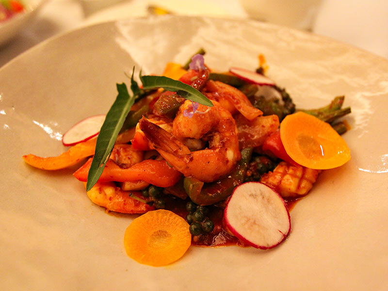 Stir fried squid and prawn with green peppercorn served for dinner at the restaurant of Jaya House River Park hotel, in Siem Reap, Cambodia, photo by Ivan Kralj