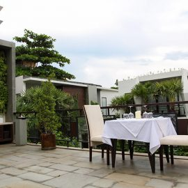 Jaya House River Park hotel terrace, with a dinner table set for two, in Siem Reap, Cambodia, photo by Ivan Kralj