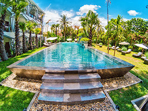 Silver-tiled swimming pool in the garden of Jaya House RiverPark hotel in Siem Reap, Cambodia, photo by Ivan Kralj