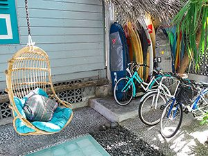 Swinging chair, surf boards and bicycles at Kosta Hostel, Seminyak, Bali, Indonesia, photo by Ivan Kralj