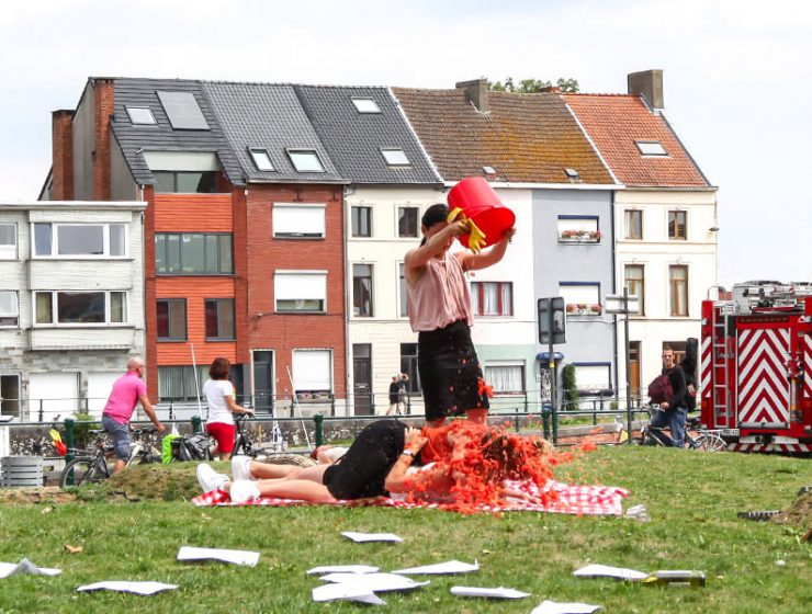 "Female performers in Cie Woest's show ""Lucky Shots"" spilling several liters of tomato puree over fellow performers, at Miramiro street theatre festival in Ghent, Belgium, photo by Ivan Kralj"
