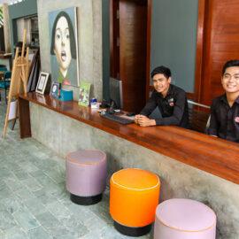 Smiling staff at Rambutan Resort Phnom Penh reception, Cambodia, photo by Ivan Kralj