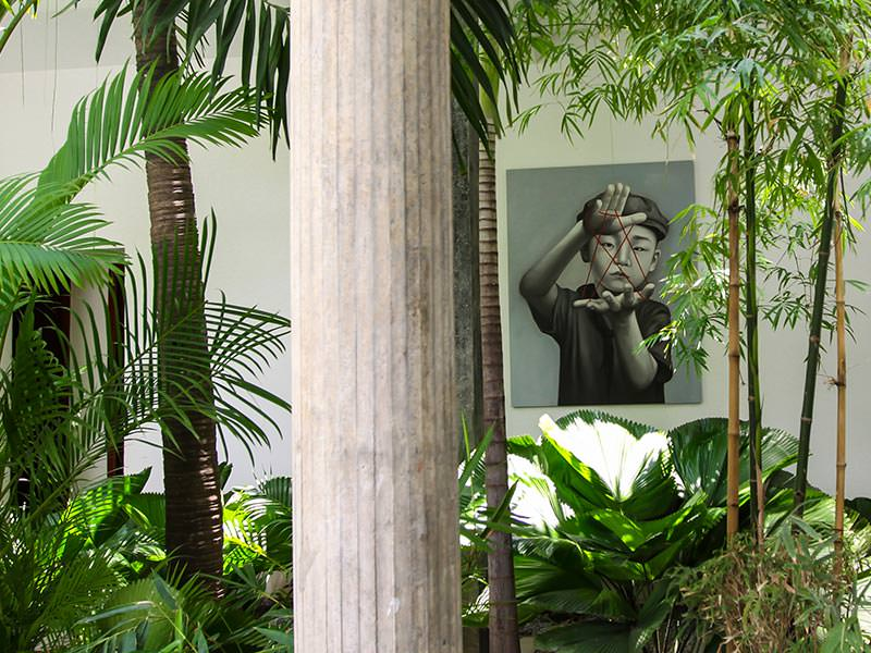 Painting by Christian Develter surrounded by greenery at Rambutan Resort Phnom Penh, Cambodia, photo by Ivan Kralj