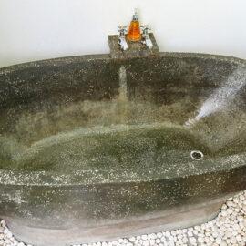 Stone bathtub at the balcony in Rambutan Resort Siem Reap, Cambodia, photo by Ivan Kralj