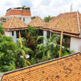 Red-tiled roof and green courtyard at Rambutan Resort Siem Reap, Cambodia, photo by Ivan Kralj