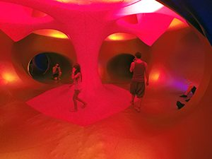 Red interior of Luminarium art installation, inflatable labyrinth of tunnels and domes at Sziget Festival 2017 in Budapest, Hungary, photo by Ivan Kralj