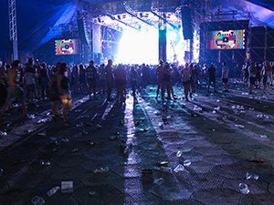 A38 stage audience space at Sziget Festival 2017 in Budapest, Hungary, the floor is covered with used plastic cups, photo by Ivan Kralj