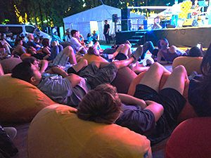 Audience members laying on several bean bags with legs in the air, at the classical concert at Sziget Festival 2017 in Budapest, Hungary, photo by Ivan Kralj