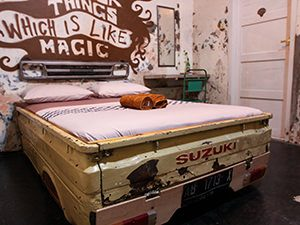 Suzuki car frame recycled into a bed frame at Abrakadabra Artbnb, one of the best hostels of Java, in Yogyakarta, Indonesia, photo by Ivan Kralj