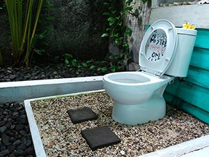 Outdoor toilet with pebbles under the toilet seat, in Beach Room of Abrakadabra Artbnb, one of the best hostels of Java, in Yogyakarta, Indonesia, photo by Ivan Kralj