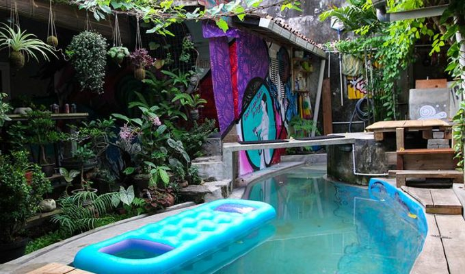Small swimming pool, surrounded with plants and graffiti, as a central point of Abrakadabra Artbnb, one of the best hostels of Java, in Yogyakarta, Indonesia, photo by Ivan Kralj