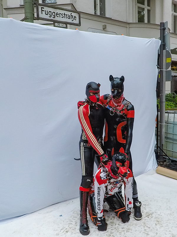 Three human puppies posing for a photo at Folsom Europe Street Fair, the biggest European gay fetish event, in Berlin, Germany, photo by Ivan Kralj