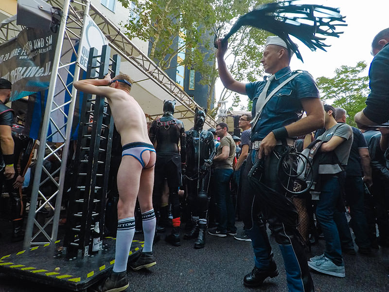 A bottom boy in jockstraps is being whipped by a master at Folsom Europe Street Fair, the biggest European gay fetish event, in Berlin, Germany, photo by Ivan Kralj