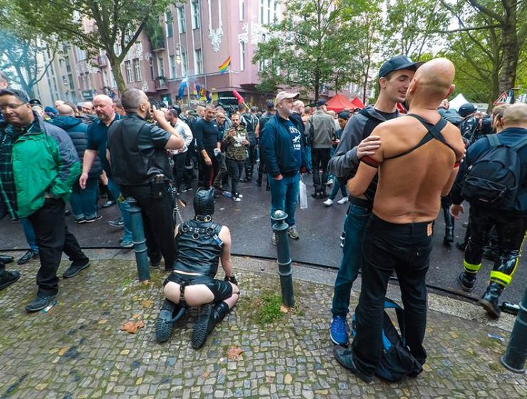 Leather cigar man with a human puppy on a leash at Folsom Europe Street Fair, the biggest European gay fetish event, in Berlin, Germany, photo by Ivan Kralj