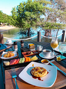 Pineapple pancake with palm sugar syrup, served for breakfast on the beach with mangrove trees, at The Menjangan, one of the answers to where to stay in Bali, Indonesia, photo by Ivan Kralj