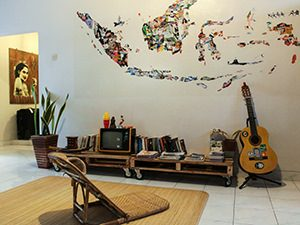 Guitar, analog TV and other vintage details in the lounge of Sae Sae, one of the best hostels of Java, in Yogyakarta, Indonesia, photo by Ivan Kralj