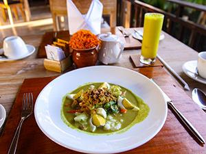Bubur Ayam, Balinese-style porridge, with Jamu Kunyit, turmeric herb juice, served for breakfast at Sankara Ubud Resort, one of the answers to where to stay in Bali, Indonesia, photo by Ivan Kralj