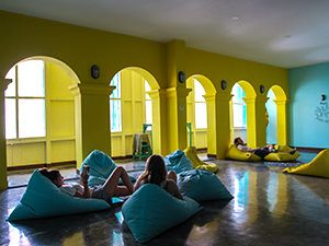 Guests resting on bean bags in a lounge at Wonderloft, one of the best hostels of Java, in Jakarta, Indonesia, photo by Ivan Kralj