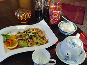 Wok dish with chicken, cashew nuts and rice, with jasmine tea, at Taste of Vietnam restaurant in Stockholm, Sweden, photo by Ivan Kralj