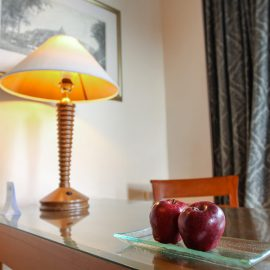 Two red apples and a lamp at the table in the room at Hyatt Regency Yogyakarta hotel in Jogjakarta, Indonesia, photo by Ivan Kralj