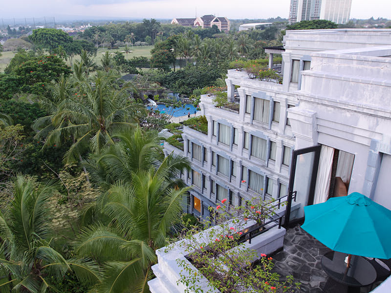 Views from the roof of the Hyatt Regency Yogyakarta hotel with lush tropical garden and swimming pools, in Jogjakarta, Indonesia, photo by Ivan Kralj