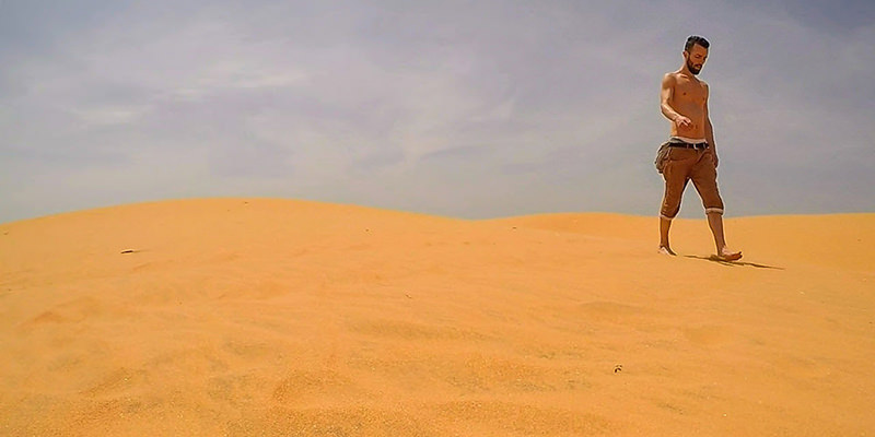 Shirtless Pipeaway blogger Ivan Kralj walking over the Red Dunes sands in Mui Ne, Vietnam - photo by Ivan Kralj