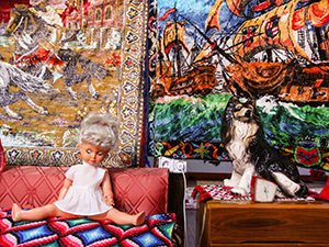 Plastic doll and porcelain dog decorating the typical Romanian late 20th century flat in Romanian Kitsch Museum in Bucharest, Romania, photo by Ivan Kralj