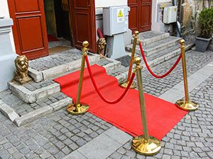 Little red carpet and golden lions at the entrance to the Romanian Kitsch Museum in Bucharest, Romania, photo by Ivan Kralj
