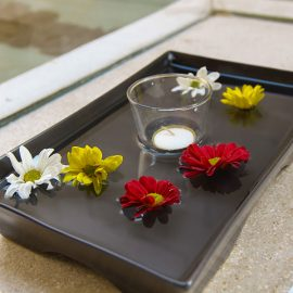The decorative flowers floating in the plate with water and candle in the bathroom of the private pavilion at the Balé resort in Nusa Dua, Bali, Indonesia, photo by Ivan Kralj