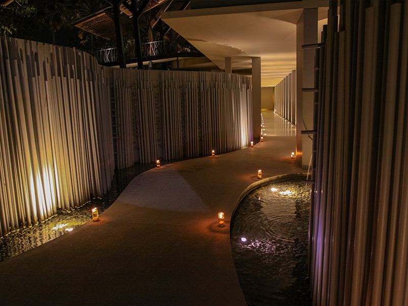 Futuristic pathway surrounded by metal tubes, water and candles, at the entrance to the Balé resort in Nusa Dua, Bali, Indonesia, photo by Ivan Kralj