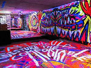 Colorful basement in ART'n'SHELTER hostel in Tokyo, Japan, covered with psychedelic illuminating graffitis by the artist called Zon, photo by Ivan Kralj