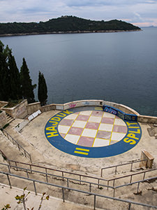 "The amphitheater in the abandoned Hotel Belvedere Dubrovnik, that was used as a filming location for the battle of Oberyn and Mountain in ""Game of Thrones"" series - crest of House of Baratheon was repainted with the crest of Hajduk football club, photo by Ivan Kralj"