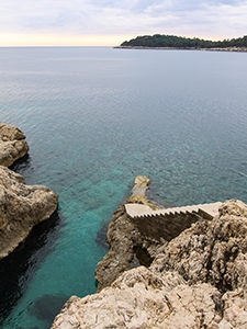 Stairs leading into the sea in front of the abandoned Hotel Belvedere Dubrovnik, Croatia, photo by Ivan Kralj