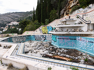 The graffiti and garbage covered swimming pool at the abandoned Hotel Belvedere Dubrovnik, Croatia, photo by Ivan Kralj